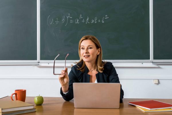 depositphotos_229024016-stock-photo-female-teacher-sitting-at-computer
